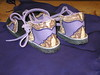"Misty is a creative soul!  Her Two Tab Sandals are Lavendar Bullhide, with Goat Snakeskin Trim, and an Eggplant Purple Underlay.  Wow!<br /> Check out Misty's amazing sustainable socks at  <a href=""http://www.rocknsocks.net"">http://www.rocknsocks.net</a>."