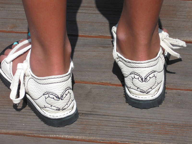 Melissa's birth day sandals are made from white buffalo hide, with black stitching.  Her heel art idea is the 'loving hands' - as sweet as she is!  The soling is Vibram Newflex.