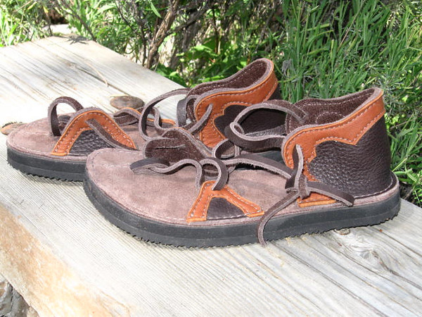 Two tab sandals in Chocolate, with Burnt Cork Deerskin trim,, Thick Cushi Midsole, and Spikeless Golf Vibram Soling.