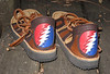Nothing for the head like the good old Grateful Dead!  Tobacco Four Tab Sandals, Trimmed in Chocolate Deerskin, Heel design is 13 Point Lightening Bolt in Red, White, and Blue Deerskin, Thick Cushi Midsole, Spikeless Golf Vibram Soling.