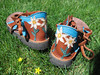 Beautiful flowers for a sweet flower child, in remembrance of her mother's grace.<br /> These are Tobacco two tab sandals, with turquoise blue deerskin trim, and flowers appliqued on the heels in white, gold, and green deerskin.  This pair has thick cushi midsole and Spikeless Golf Vibram soling