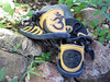 Four tab sandals, black with gold deerskin trim.  Inset on heels - Left - Om, Right - Seed of Life.