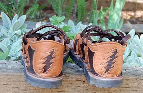 Dancing shoes!  4 tab sandals in chocolate bullhide, with burnt cork deerskin trim, and a 13 point lightening bolt cut-out on the heel.  Soling is thin cushi and Vibram Newsole #1.  See you on the dance floor!