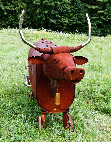 Bull grill with mufflers and bell.
