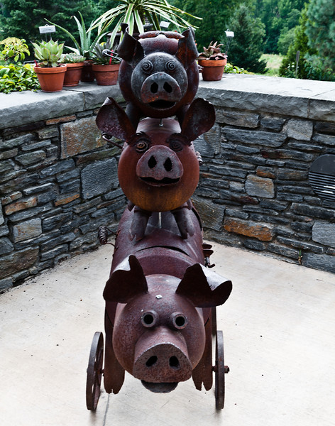 Stack of three grill pigs.