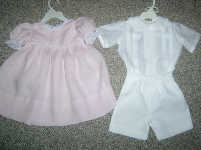 brother and sister outfits.  The girls dress is made from pink linen with white lace.  The boys suit is made from white linen.