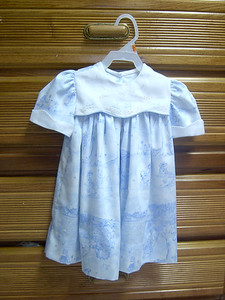 yoke overlay dress made in blue toile, with shadow embroidery on overlay