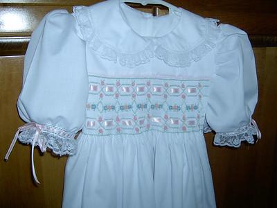 yoke dress of white batiste smocked with ribbon