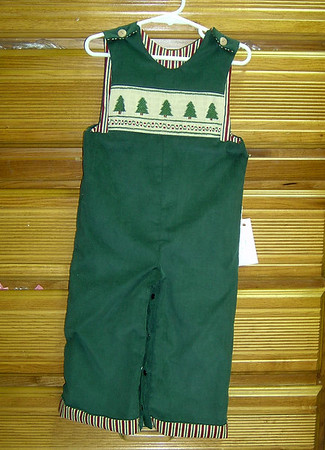 long pants jumper in green pinwale corduroy smocked with Christmas trees
