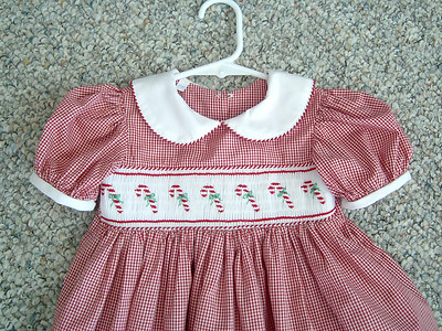 yoke dress in small red and white check smocked with candy canes