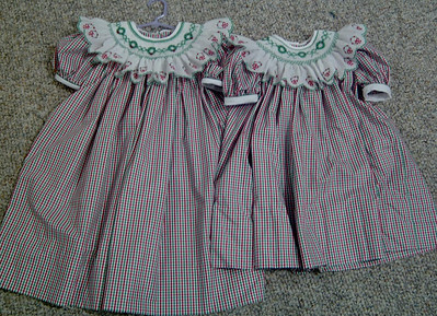 sisters dresses yoke dresses in red/green/white check with smocked swiss edging collars