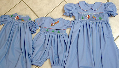 coordinating Christmas outfits, bishop dress, romper with yoke overlay and a yoke dress made from blue imperial batiste