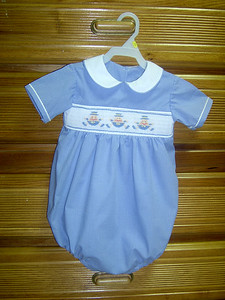 blue and white microcheck bubble with Humpty Dumpty smocked