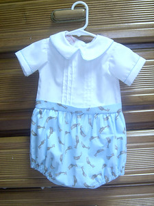 bubble bottom of blue pique and top white broadcloth.  one piece romper