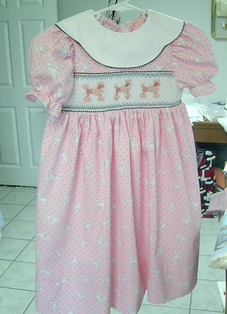 yoke dress in pink pique with poodles , smocked with poodles