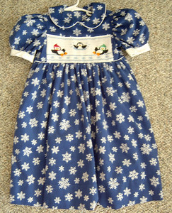 yoke dress in blue corduroy with snowflakes and smocked with penquins
