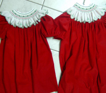 sisters dresses in red pinwale corduroy with bishop collars of swiss edging