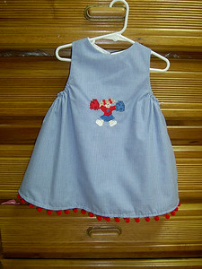 jumper in blue and white microcheck with cheerleader appliqued