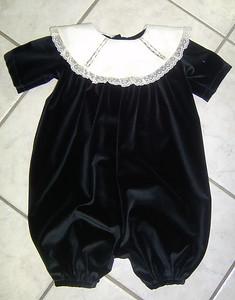 romper of black velvet and ecru linen collar