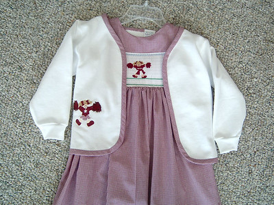 wrap around jumper dress in maroon and white microcheck with cheerleader smocked. Also a white sweatshirt jacket with cheerleader appliqued
