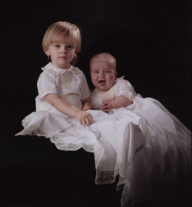 photograph of Sterling and Saxon taken by Laura Cantrell Photography of Mobile, AL.  Saxon in his Christening gown of white nelona and ecru lace.Gown skirt has panels with diamond shaped godets. Sterling in heirloom shorts and shirt made from white nelona and ecru lace.