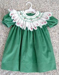 yoke dress in green pinwale corduroy with bishop collar smocked with wreaths