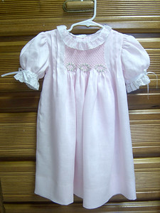 smocked dress made from pink linen with white lace, buillon roses on smocking