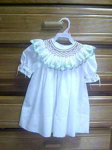 white broadcloth yoke dress with a bishop collar made from swiss edging.