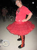 Boots just want to have fun!  And so do the girls wearing them!<br /> This is this year's playa delivery - right at the Fire Dancing Stage on Tutu Tuesday.  How appropriate for a pair of flaming fire boots!<br /> Black Buffalo Hide, Red Wave/Flame Button Trim going up the leg, Orage Goat Underlay, and Gold Deerskin Underlay, Flame Tabs, Purple Heels with Burning Man applique, Very Thick Cushi Midsole, Spikeless Golf Vibram Soling, Glass Flame Buttons alternating with Antler Crowns.<br /> WOW!