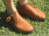 High one button moccasins - about an inch or so higher than a low one button, goes just above your ankle bone.  Can also be a two button and go slightly higher.