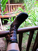 Deva is kicking back on the porch in Amazon with her yummy boots on!