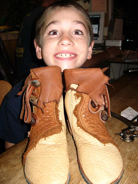 So cute!!  This is my nephew, Ryan, and his new moccasins.  He is quite the leather worker, don't you think?  These boots are taking Ryan to fun places - with Boy Scouts, and with school trips, and who else knows where??