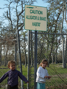 Xavier and Abigail with Sign in Texas