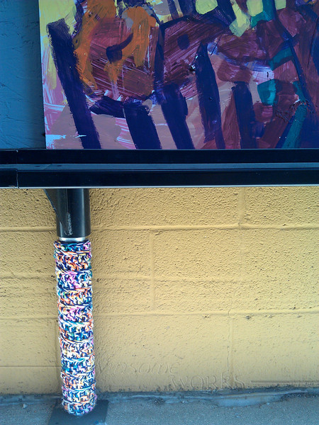 Yarn bombed post on mural in Art Alley - Goshen, IN