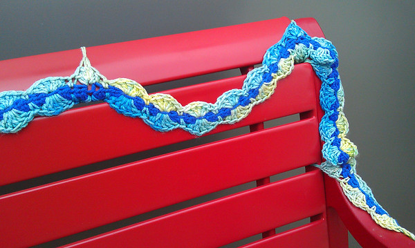 Yarn bombing on bench in Art Alley - Goshen, IN