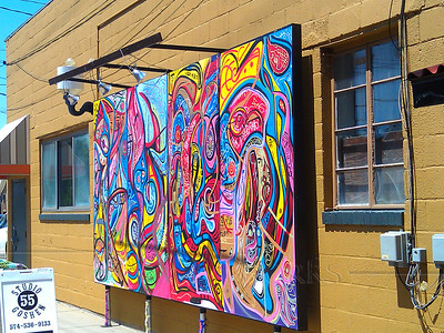 Mural with yarn bombed posts in Art Alley - Goshen, IN