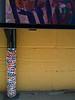 Yarn bombed post on mural in Art Alley - Goshen, IN