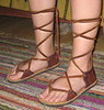 Long laces are an option on the sandals.  They are laces that criss cross up your leg.  They aren't very practical, but... sometimes practical isn't what we want!<br /> 'Tabs' on a sandal are the pieces on either side of the foot that the lace goes through.  Sandals are named either 'Two Tab' or 'Four Tab'.