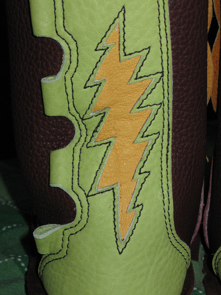 13 point lightenbolt going up the back of the leg on a pair of five button boots - rockin!