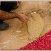 Working on a religious mural with petals © Canarybird 2009