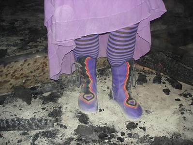 Yep, those are my boots... it's a purple heart thing... having their debut on the playa for Burning Man 2007. Yep, I'm a Burner!  A little bit of decomposed fish excrement never hurt any one - that is unless you don't wash it off!  Good thing our boots are washable!  What you can't tell in the photo is that I am standing in flames!!!  The coals around my feet are all either glowing or flaming, and there were pretty big flames behind me.  Whoohoooo for fun in the fire!  Thank you Danno, for the great picture!