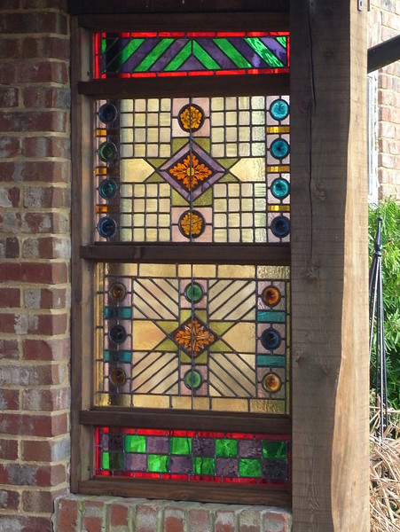 Two original panels fitted into the frame, with newly-made infill panels above and below.