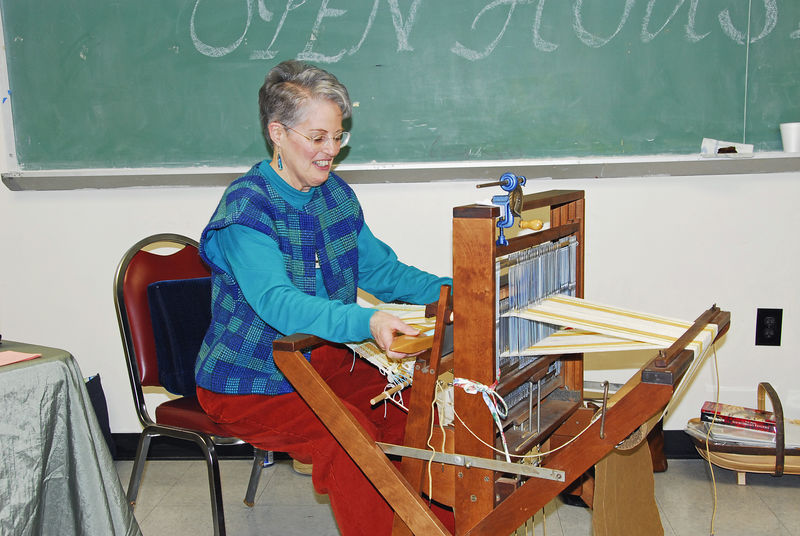 Kay, a weaver/teacher with 30 years of experience, demonstrates