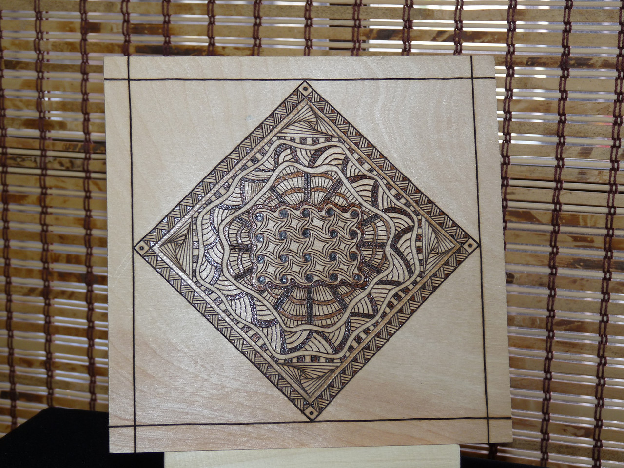 love this -- it's one of the things that grabbed my interest in taking the class -- a pyrography (woodburned) tile.  Beautiful!