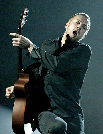 Ottawa-02/24/03-Coldplay in concert at the Corel Centre. Lead Singer, Chris Martin. Photo by Patrick Doyle.