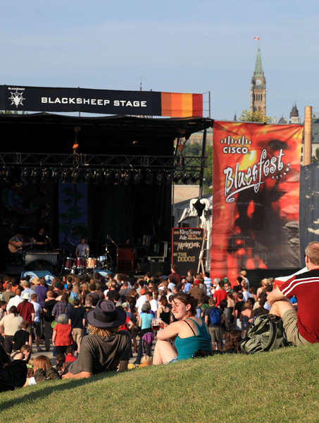 Music fans watch the Blacksheep Stage with the Parliament Buildings in the background at the Cisco Ottawa Bluesfest on Friday, July 10, 2009. The Ottawa Bluesfest is ranked as one of the most successful music events in North America. Patrick Doyle/Ottawa BluesFest/The Canadian Press Images.