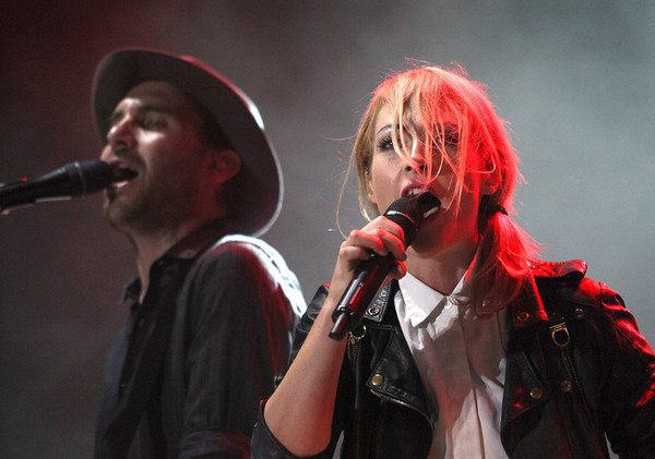 Emily Haines (R) and James Shaw of the band Metric are seen here performing at the RBC Royal Bank Bluesfest in Ottawa on Sunday, July 15, 2012. The Ottawa Bluesfest is ranked as one of the most successful music events in North America. The Canadian Press Images PHOTO/Ottawa Bluesfest/Patrick Doyle.