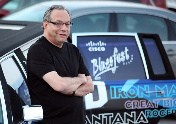 Comedian Lewis Black poses for a photo with the Bluesfest Limo before he performs at the Cisco Ottawa Bluesfest on Saturday, July 17, 2010. The Ottawa Bluesfest is ranked as one of the most successful music events in North America. The Canadian Press Images PHOTO/Ottawa Bluesfest/Patrick Doyle.