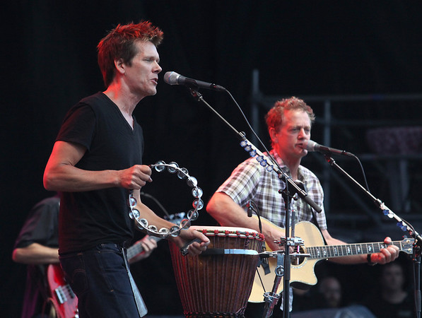 Kevin Bacon (left) and Michael Bacon perform as the Bacon Brothers at the Cisco Ottawa Bluesfest on Thursday, July 8, 2010. The Ottawa Bluesfest is ranked as one of the most successful music events in North America. The Canadian Press Images PHOTO/Ottawa Bluesfest/Patrick Doyle.