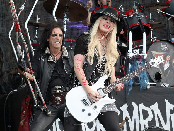 Alice Cooper (L) is seen here performing with guitarist Orianthi at the RBC Royal Bank Bluesfest in Ottawa on Saturday, July 7, 2012. The Ottawa Bluesfest is ranked as one of the most successful music events in North America. The Canadian Press Images PHOTO/Ottawa Bluesfest/Patrick Doyle.